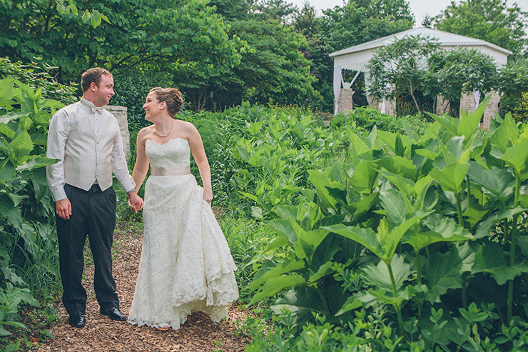 Married couple walking through garden
