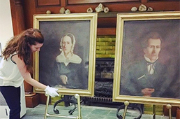 Instructor with historic paintings