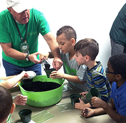 Volunteer potting plants with students