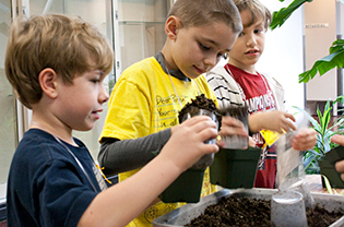 Students planting during a Garden class