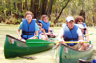 ECO-ACT participants canoe during their summer session