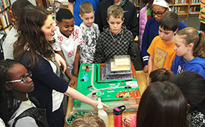 Students with landfill model