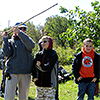 Students learn to throw an atlatl