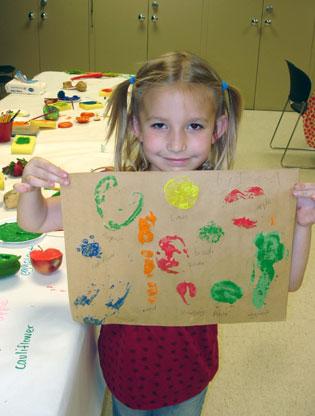 Girl with veggie prints