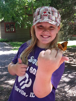 Girl scout with butterfly