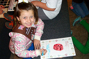 Brownie drawing a ladybug