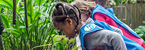 Girl Scout Daisies investige aquatic plants in Climatron