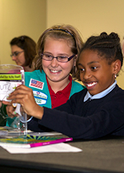 Girl scouts working together at program