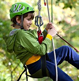 Boy in climbing gear