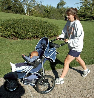 Participant pushing stroller around Japanese Garden path