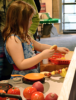 Girl experiements with preparation of vegetables as food