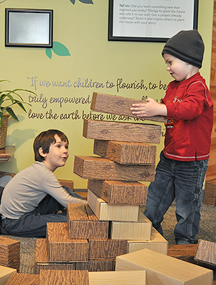 Boys playing with blocks in the Nature in Your Neighborhood exhibit