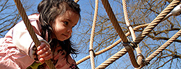 Girl climbing ropes in Children's Garden
