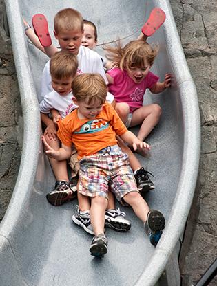 Children slide down spelunkers slide