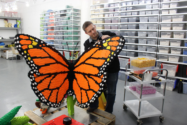 Sean Kenney building a butterfly with LEGO bricks