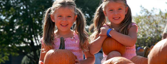 Girls with pumpkins at the Best of Missouri Market