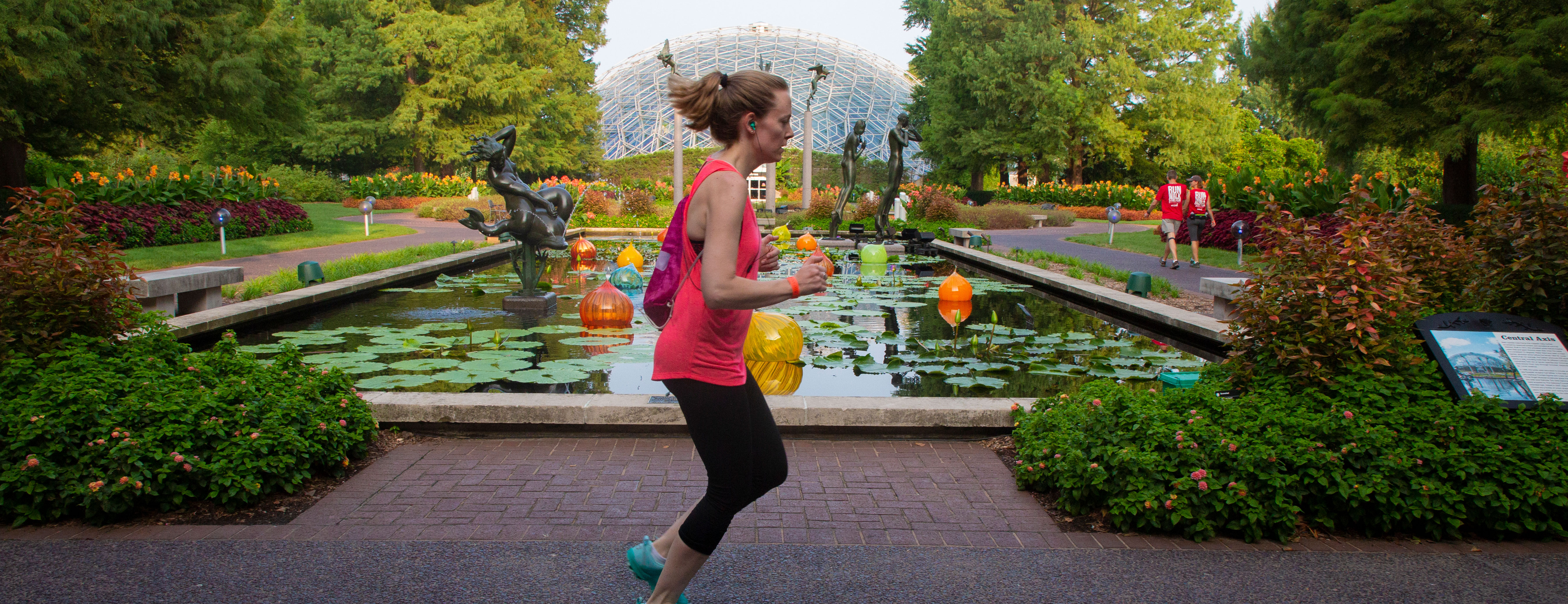 Woman running past the Climatron