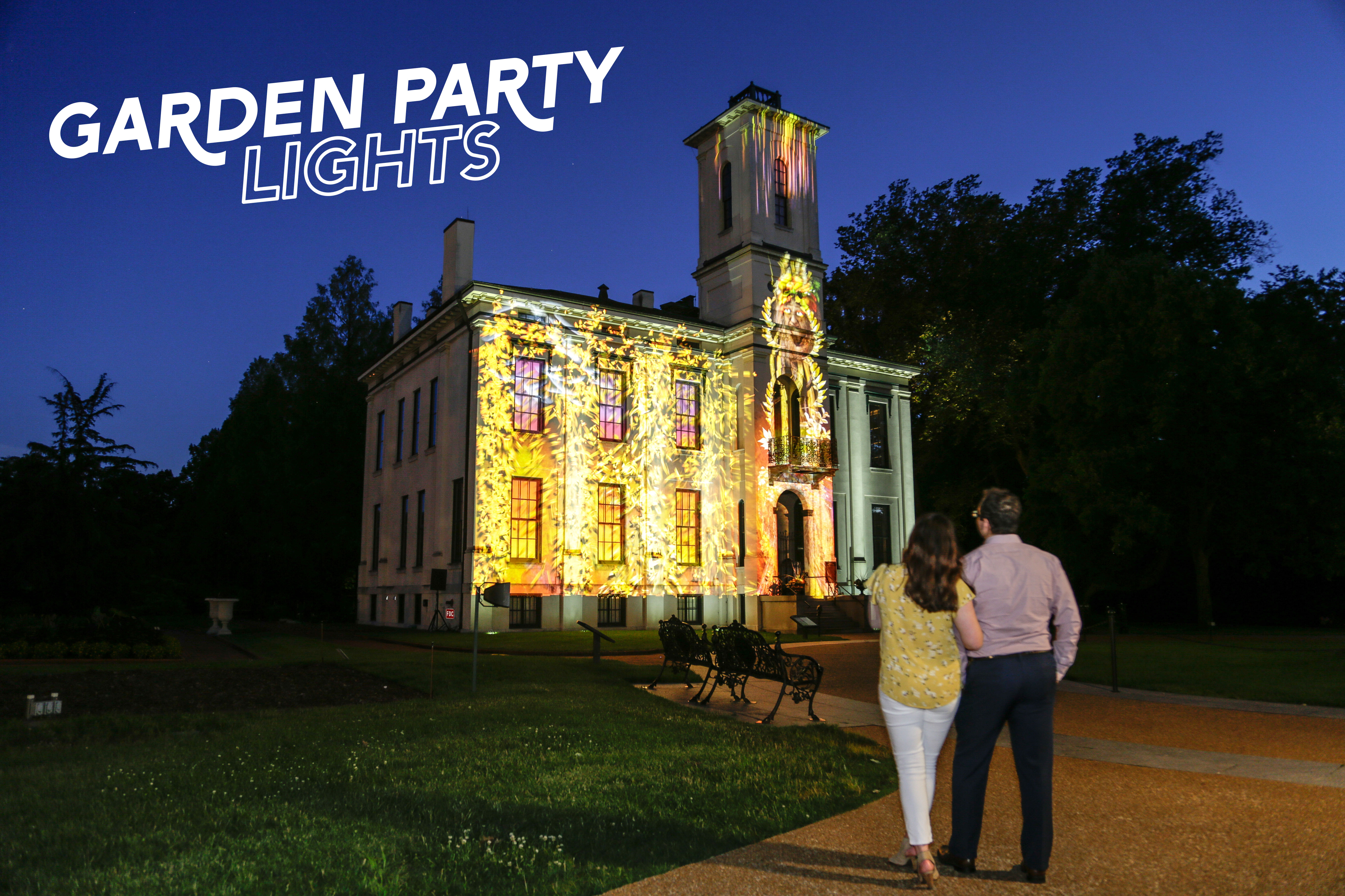 Couple viewing Tower Grove House transformed during Garden Party Lights