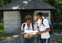 Hikers consulting a map