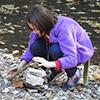 Girl stacking rocks