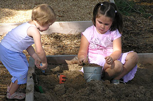 Children dig in sand