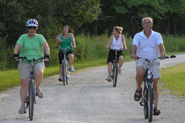 Adults enjoying an evening bike ride at SNR