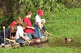 Kids doing water sampling from dock