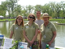 Volunteers assist at an Earth Day celebration