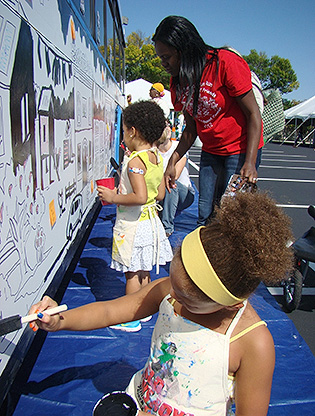 Kids painting bus
