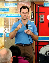 Speaker giving presentation on home energy efficiency