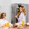 Mother and daughter with refrigerator