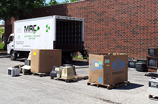 MRC truck picking up tvs and monitors