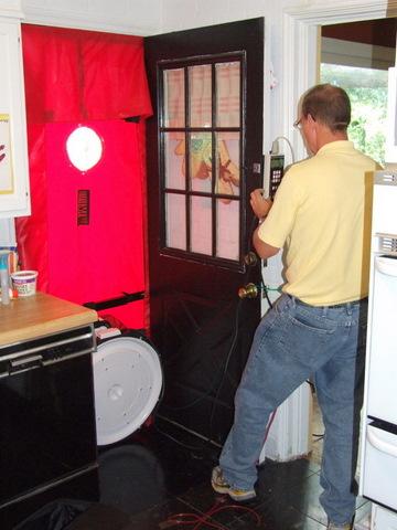 Man with blower door; photo by Korey Hart