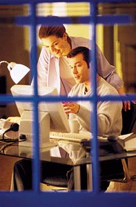 Couple seen through window pane