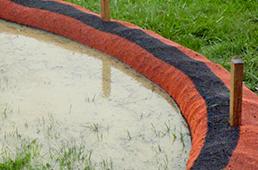 Compost sock dam holding rainwater