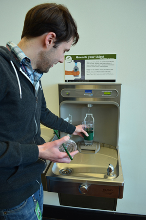 Refilling water bottle at a hyrdration station