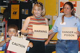 Student and two teachers present on toxin labeling
