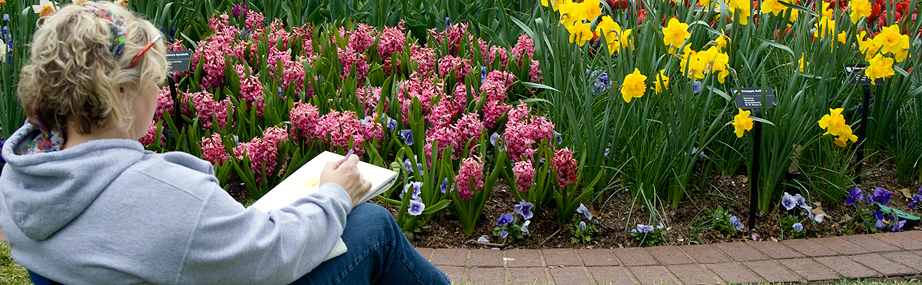 Woman paints spring flowers