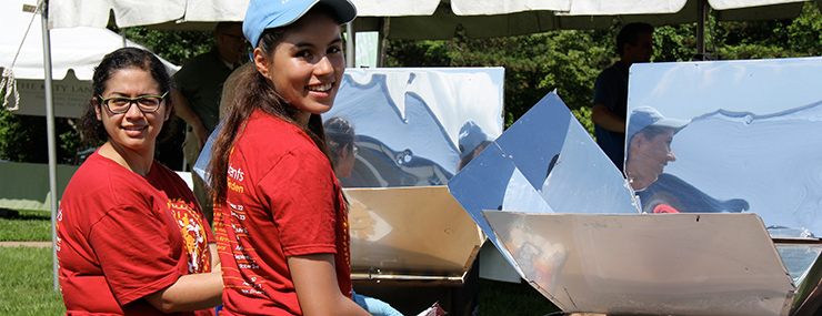 Ladies cooking at a solar cooker
