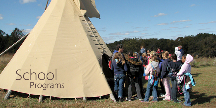 School group at tipi on prairie