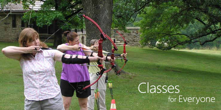 Women learning archery