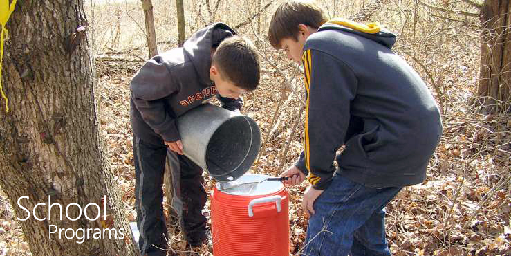 School Programs--boys straining maple syrup