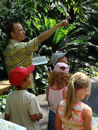Teacher leading campers through Climatron