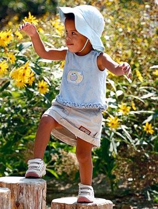 Girl climbing in Children's Garden