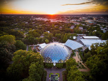 Arial view of Climatron and surrounding buildings with sunset
