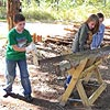 Students sawing wood