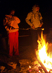 Scouts roasting marshmallows at campfire