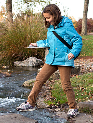 Girl Scout crossing stream