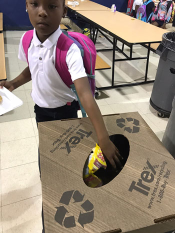 Student recycles plastic bag in Trex container