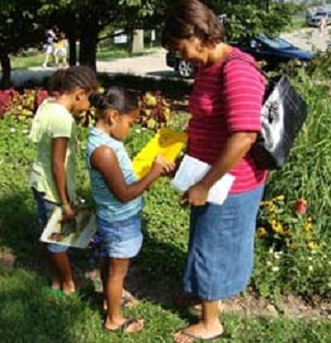 Children in pollinator garden